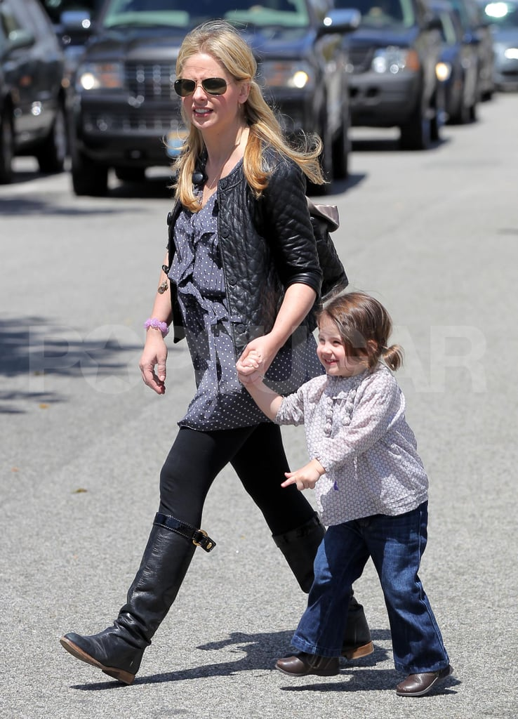 Sarah Michelle Gellar held hands with daughter Charlotte Prinze.