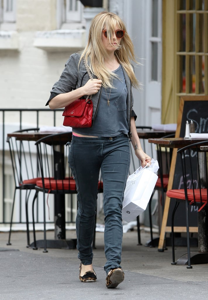 Sienna Miller stuck to a gray palette during a day out in NYC, then punched it all up via a red quilted Roger Vivier bag and her leopard loafers.