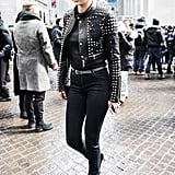 No matter how many black outfits you wear for Fall, you only need one piece (like a cool studded leather jacket) to make it stand out.