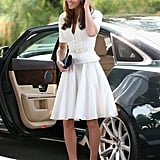 Kate Middleton stepped out of the car wearing a white dress and blue cork wedges.