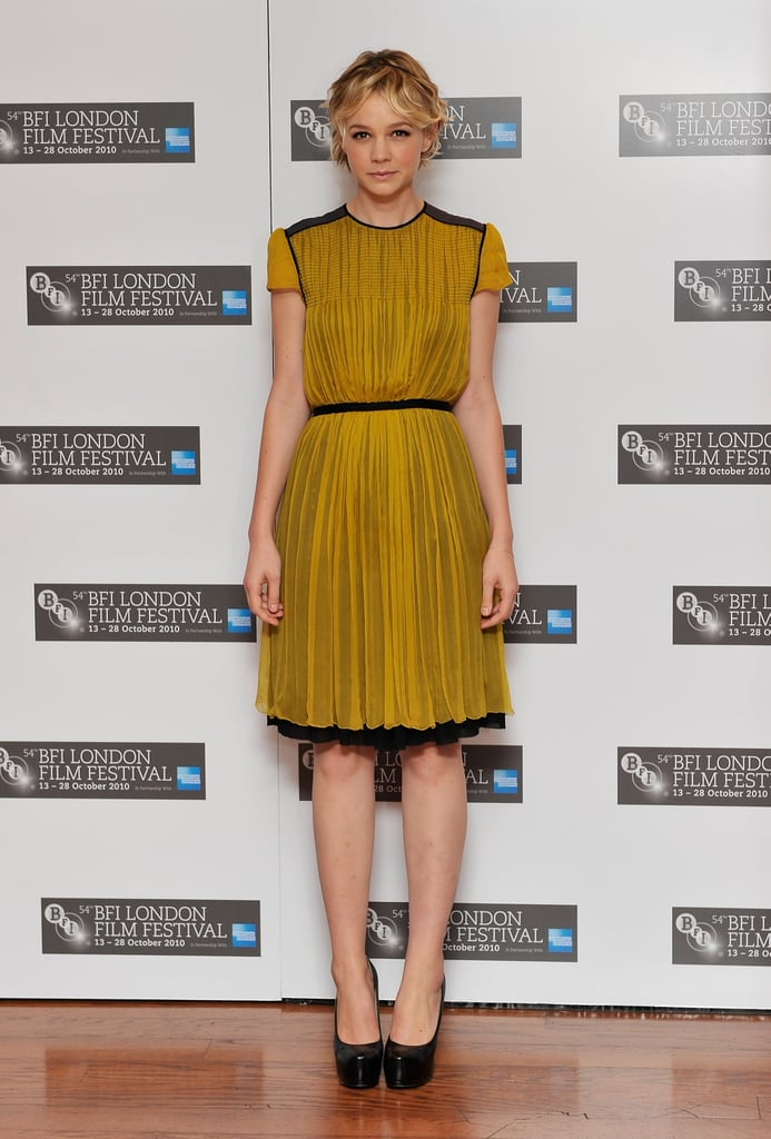 Carey glowed in a mustard Proenza Schouler dress with black trim detail and matching YSL platforms at a London photocall for Never Let Go.