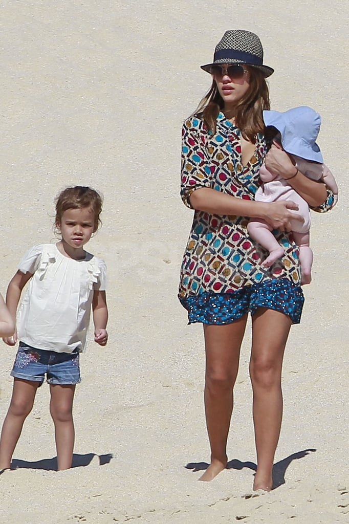 Jessica Alba had her daughters, Haven Warren and Honor Warren, with her as she strolled in Cabo yesterday. The mother of two enjoyed some girl time, taking a break in the shade with her infant while Honor played in the sand. Today, Jessica wore a casual coverup and a hat for her walk along the shore. Earlier this week, however, Jessica sported a bikini and showed off her postbaby figure as she took a dip in the pool with Cash Warren and their kids.  The Alba-Warren family was clearly in the holiday spirit this year. Jessica was spotted at Toys R Us last week buying Honor a bright pink, electric Barbie car and also took her oldest for a visit to Santa. Just after Christmas weekend the foursome headed South to enjoy the warm weather. Their arrival in Mexico didn't go unnoticed by Jessica's fans, and shortly after they arrived, she happily obliged to pose for some pictures.