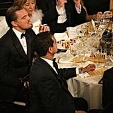 Leonardo DiCaprio lit up an electronic cigarette at his table.  Source: Christopher Polk/NBC/NBCU Photo Bank/NBC