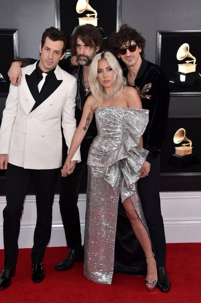 Mark Ronson is wearing Celine by Hedi Slimane.