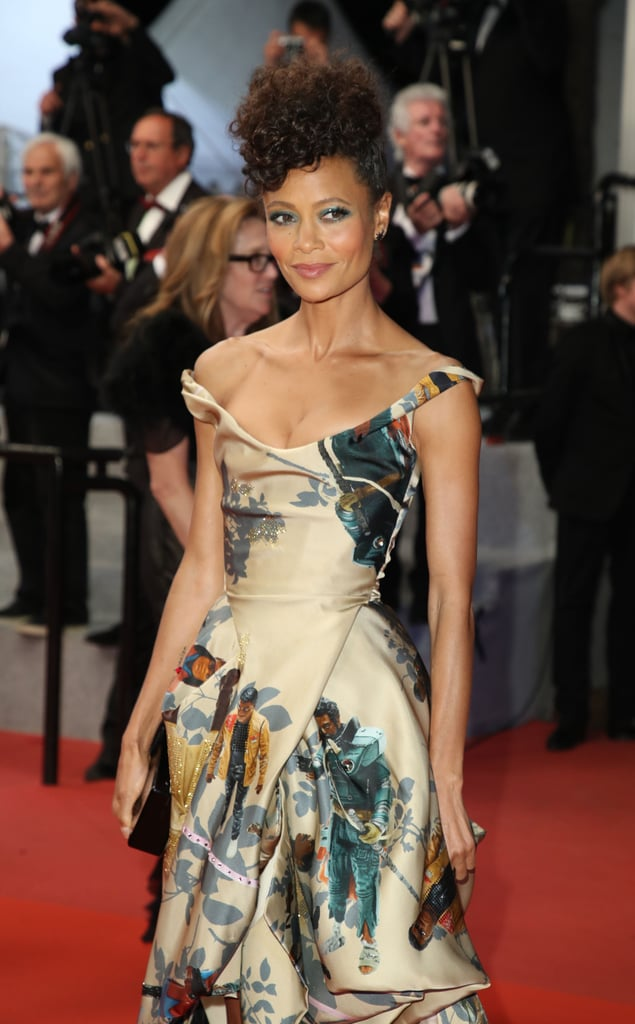 "All eyes were on Thandie Newton and her custom Vivienne Westwood gown while she walked the Cannes red carpet at the Solo: A Star Wars Story premiere on May 15. At first glance, the dress appears simply to be an elegant off-the-shoulder gold gown, but look closer and you'll notice action figure illustrations of the black male Star Wars characters, a significant statement for both the actress and the franchise.  Thandie's stylist, Erin Walsh, posted a sketch of the breathtaking dress on Instagram and revealed the inspiration behind it. ""Thandie had the brilliant idea to make a dress covered in a print with photos of iconic black Star Wars characters!"" Erin wrote in the caption. ""She wanted to celebrate her role in the iconic history of the franchise!"" Thandie is the first black woman to have a leading role on screen in a Star Wars movie, which is definitely a part worth celebrating! Her gown is a nod to the black characters who came before hers — like Finn, Saw Gerrera, Mace Windu, Captain Panaka, and Lando Calrissian — and symbolizes a hopeful future for further diversity in the franchise with her character Val."