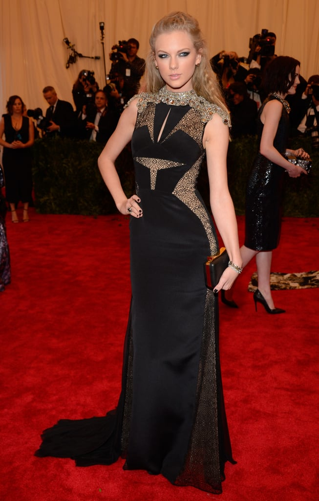 Taylor Swift transformed from a country cutie to a true punk when she walked the red carpet at the 2013 Costume Institute Benefit at the Metropolitan Museum of Art in NYC tonight. She pumped up the edge with a J. Mendel black gown, dramatic smoky makeup, and a slicked-back hairdo. Taylor is no stranger to the fashionable event, having attended the bash twice before, in 2010 and 2011. Being a musician, Taylor will surely get some inspiration from the night's theme, Punk: Chaos to Couture. Vote on Taylor's look and many more stylish stars in our Met Gala 2013 red carpet polls.