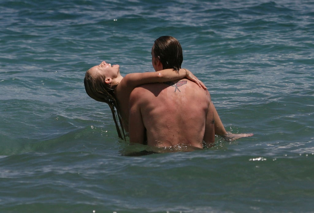 Dax held on to Kristen while they swam in Hawaii in June 2009.