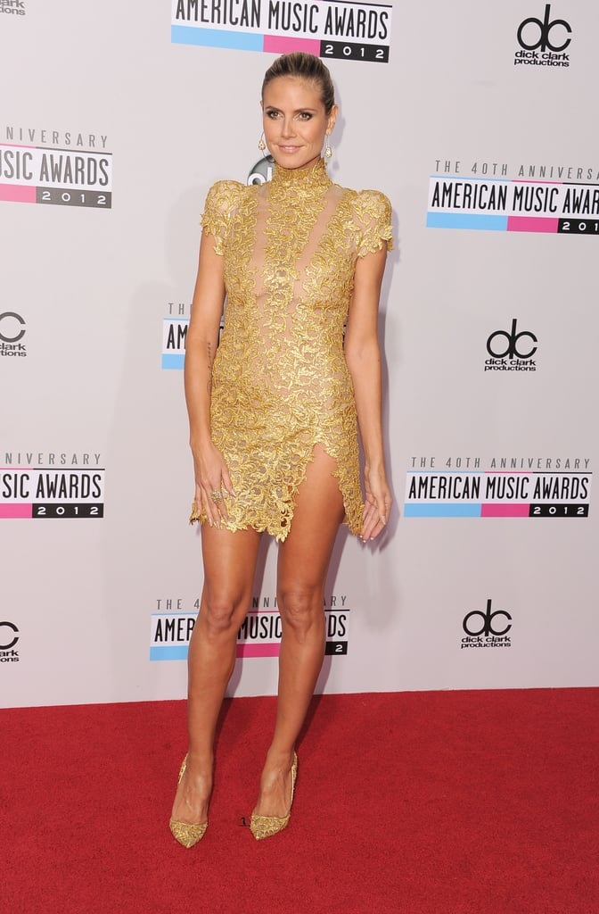 Heidi Klum hit the red carpet at this evening's American Music Awards in LA. She was decked out in a gold mini from designer Alexandre Vauthier for the occasion. Heidi tweeted earlier in the afternoon about prepping for the big show with the help of makeup artist Sabrina Bedrani and hairstylist Eric Gabriel. Heidi's presenting tonight, but last weekend, she was in her native Germany to actually host a big awards program, the MTV EMAs. It will be a little bit before Heidi's got the mic tonight — in the meantime, watch the American Music Awards preshow online now!