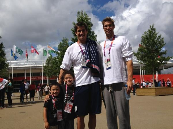 US swimmer Nathan Adrian posed with his coach's two sons. Source: Twitter user Nathangadrian