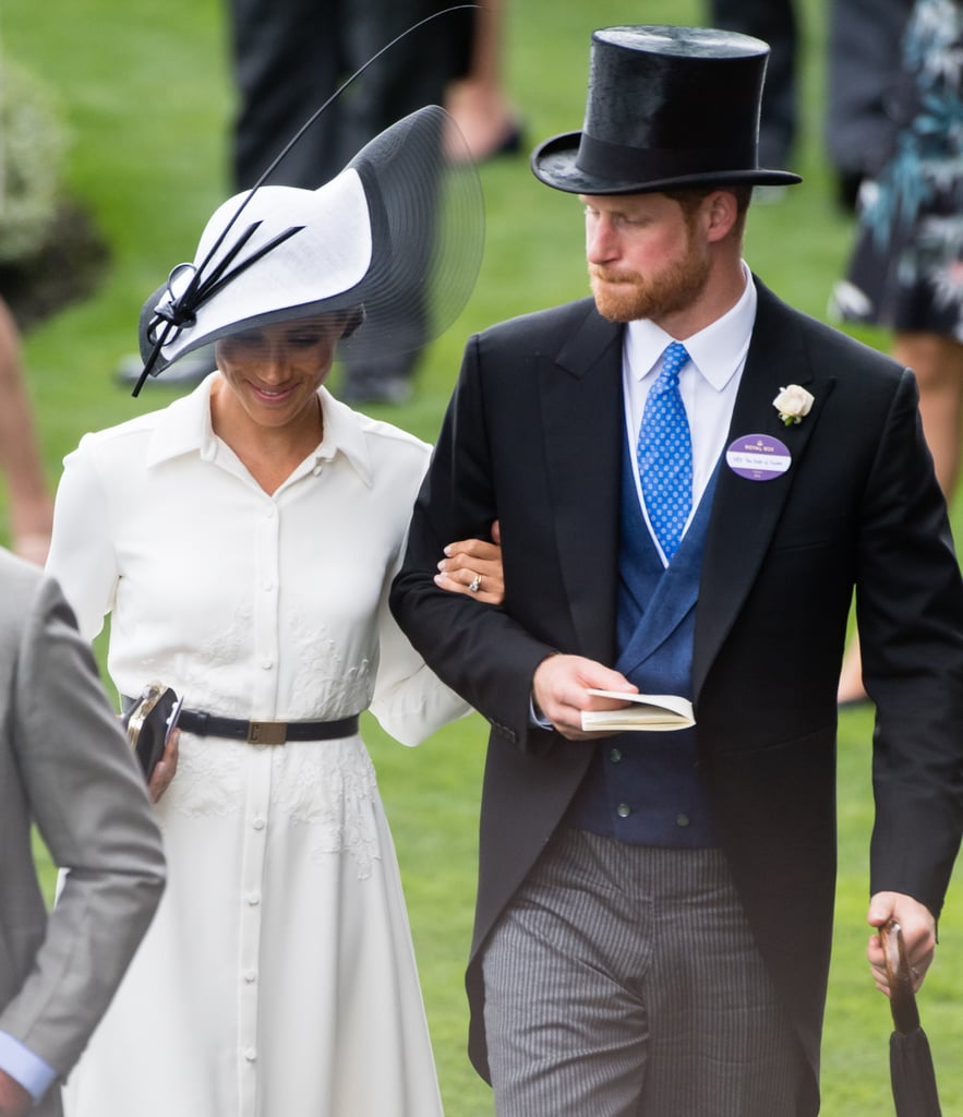 Exactly a month after their wedding, Prince Harry and Meghan Markle continued their royal duties as they attended the first day of Royal Ascot. The couple rode in the carriage procession at the annual horse racing event, sat opposite Harry's uncle, Prince Edward, and his wife Sophie, Countess of Wessex. Carriage rides seem to be a weekly occurrence for the pair at the moment — they were also seen waving to the crowds from one at the recent Trooping the Colour ceremony.  If this is what the first month of marriage is supposed to be like, there are probably a few of us feeling like we deserve a do-over right now! As they stepped down from the carriage, Harry was seen leaning in to speak to his wife, introducing her to the assembled VIPs. Meghan, in a chic white dress and black and white hat, held tightly to her husband's arm as they made their way to the royal box. Later on, the newlyweds will make the trophy presentation for the fourth race of the day, the St. James's Palace Stakes. Stay tuned for photos of that, but for now, take a closer look at the Duke and Duchess of Sussex's Royal Ascot debut.