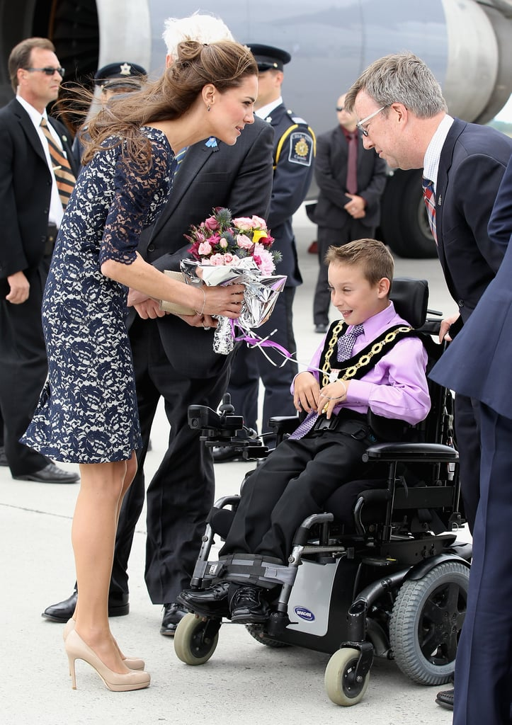Kate Middleton was greeted with flowers as she and Prince William landed in Canada.