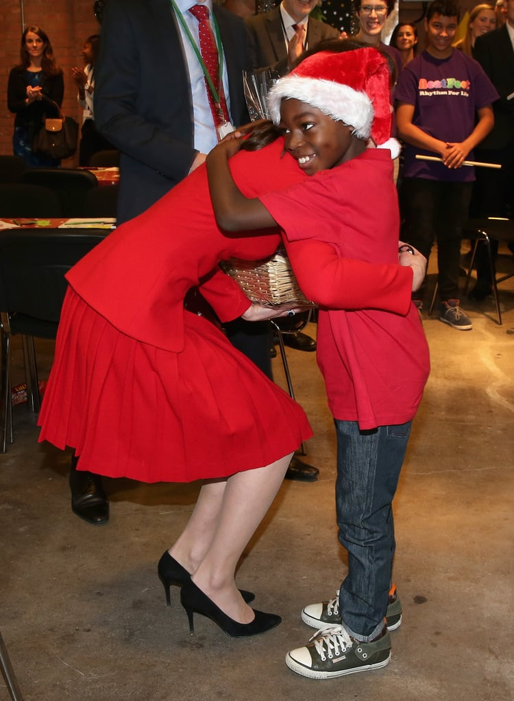 Kate showed her holiday spirit when she hugged a young boy in a Santa hat during a Christmas party in London in 2015.