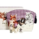 You don't have to be a cat-lover to instantly squeal over the cuteness that is the Paul & Joe Holiday Collection in Ginger ($75). The kitten-emblazoned makeup bag opens up to a tube of pale pink eye gloss, a pan of coordinated eye shadows, and a creamy cheek color in the shape of a cat! The pink palette is neutral enough to wear past the holiday season, and with packaging this cute, how can you say no? — KD