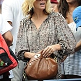 Brooklyn Decker with a brown bag.