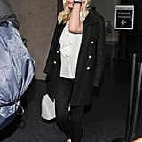 Kirsten Dunst got off a plane at LAX with Garrett Hedlund.
