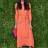 At the 13th Annual CFDA/Vogue Fashion Fund Awards wearing a belted orange Proenza Schouler dress.