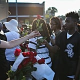 Red roses were handed out during a peaceful protest.