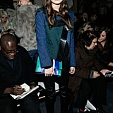 Elizabeth Olsen oozed effortless sophistication in an emerald-and-cobalt tweed jacket, slick leather pants, and dalmatian pumps at The Row. Her matching colorblock clutch was the icing on her uptown-meets-downtown style.