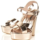 A luxe NYE shoe that give your heels a boost and some stylish support.  Topshop Lush Mirror Platform Sandals ($130)