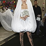Gigi Posing Backstage in Her Bridal Moschino Look