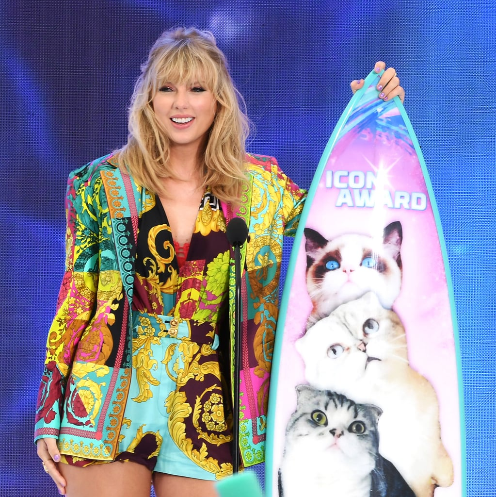 "Taylor Swift looked absolutely stunning at the Teen Choice Awards on Sunday. After enjoying a fun night out on the town with friends on Saturday night (and becoming a meme for ""Drunk Taylor""), the ""ME!"" singer hit the carpet in Hermosa Beach, CA. Taylor looked lovely in a rainbow Versace blazer and romper as she flashed a smile for photographers.  The last time Taylor graced the Teen Choice Awards was all the way back in 2014. At the time, the former country star had just crossed over to the pop genre with the release of her then-new single ""Shake It Off"" from her 1989 album. This time around, she is set to receive the first-ever icon award for her incredible achievements. Seeing how much Taylor has evolved over the years, we must say the honor is well-deserved. See more from her latest appearance ahead.       Related:                                                                                                           Taylor Swift Is Doing Better Than She Ever Was in 2019, and I'm Here For It"