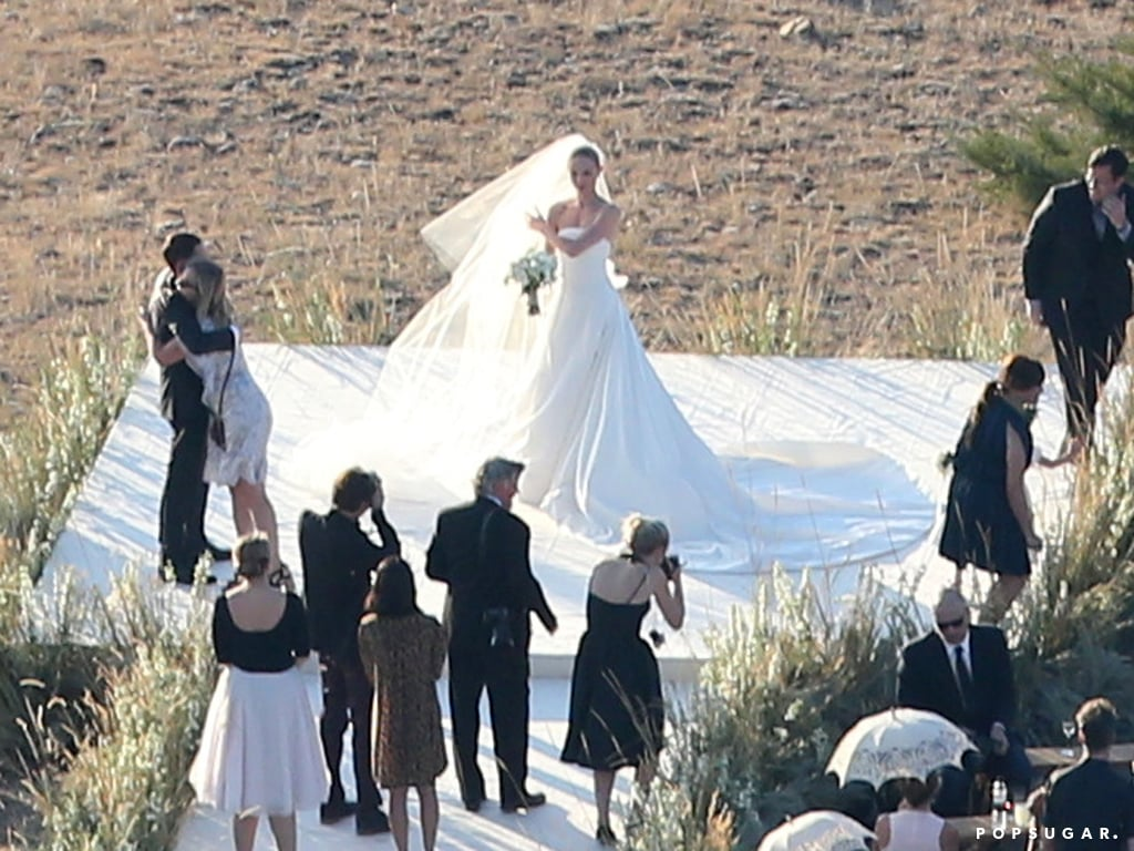 Kate Bosworth wore a custom Oscar de la Renta wedding gown with a long train.