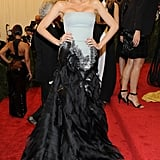 Wearing a Gucci Première feather gown, Christian Louboutin shoes, and Lorraine Schwartz jewelry to the 2013 Met Gala.