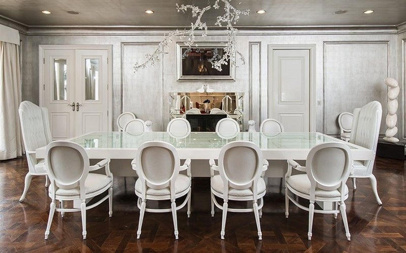 This stark, silver dining room is the perfect place for fashionable dinner parties to convene.