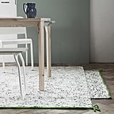 We love how this larger area rug ($60) uses white jute and black wool materials to give off a birch-tree effect.