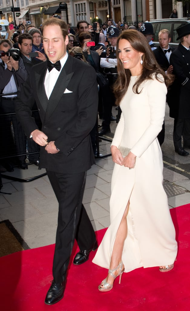 The gorgeous couple made their way down the red carpet — we love how Kate's slit moves.