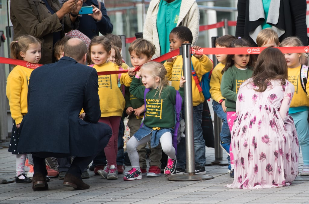 Kate and Will both knelt down to speak with kids at the London Eye in October 2016.