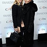 Twinning combo: For the 2013 CFDA Fashion Awards nominations, the designing duo amped up their signature styles with two different but equally cool kicks.  Ashley styled a cashmere sweater with patent sling-backs. Mary-Kate tempered her fur-trim coat with rugged lace-up leather boots.