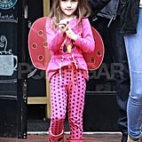 Suri Cruise wore pink with black spots.