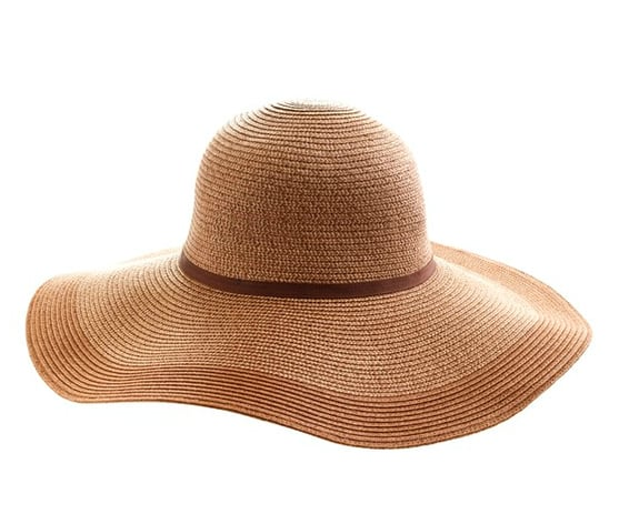 This floppy straw hat has everything you'll ever need or want from a Summer iteration: two-toned, an extra wide brim for added sun protection, and it's extremely foldable for easy packing. Need we say more? J.Crew Two-Tone Straw Hat ($38)