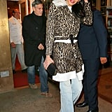 Amal worked a pair of lightwash Stella McCartney wide-leg jeans ($385) beneath a leopard two-tone coat with a shearling collar on date night. She held onto a black box clutch and cinched her waist with a matching belt.