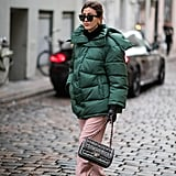 Style an Oversize Green Puffer With Pink Pants