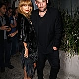 Husband and wife Nicole Richie and Joel Madden stopped to pose at a party for The Voice Australia in Sydney.