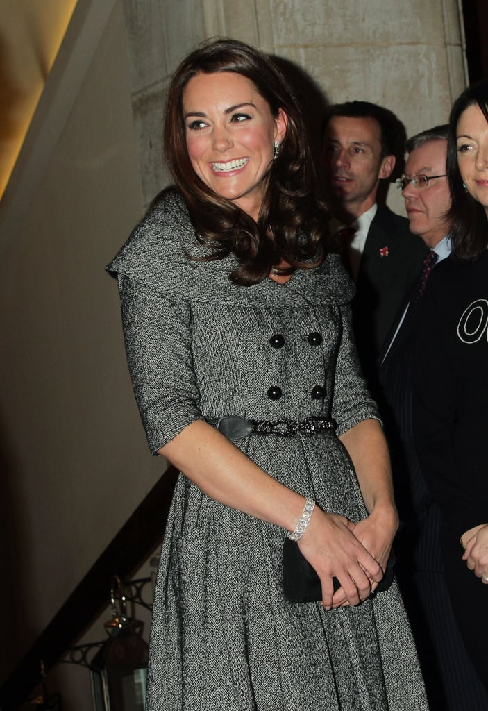 Kate Middleton, wearing a dress from the UK store Jesire, undertook a solo appearance today in London. With her husband, Prince William, away in the Falklands, she's now focusing on the institutions near to her heart. At the end of 2011, Kate announced her plans to become a royal patron of London's National Portrait Gallery. She has a long-standing interest in painting, having studied art history when an undergraduate at St. Andrew's in Scotland. Today, she stepped out to check out the museum's new exhibit from recently deceased London painter Lucian Freud. It was Kate's first solo public appearance since marrying William back in April of 2011. There may soon be a more permanent royal feature at the National Portrait Gallery. It was announced today that Kate will pose for a portrait bound for the museum.