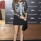 Georgia May Jagger dared to bare bones in a sheer skeleton top and a black miniskirt at the Longchamp store opening in London.