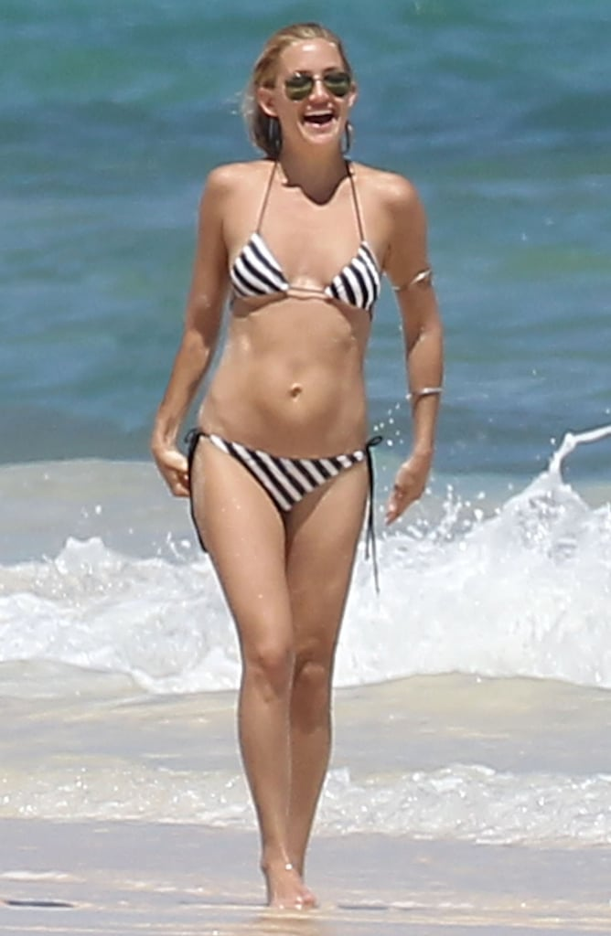 She hit the beaches of Mexico in March 2012 in a striped string bikini.