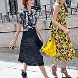 Taylor Tomasi Hill proved her style versatility once again, slipping into a tropical-print button-down, textured midi skirt, and cutout wedges. Her equally stylish companion made the rounds in a printed dress and lace-up heels.