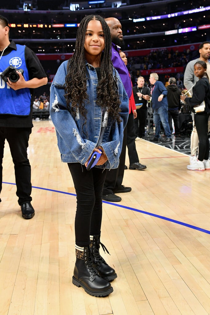 "At just 8 years old, Blue Ivy has already elevated the classic denim jacket and leggings look I've been trying to rock for ages. She accompanied her dad, JAY-Z, to the Lakers vs. Clippers game on Sunday night. Much like she did during their Super Bowl outing last month, Blue totally nailed her stylish ensemble for the event — perhaps with some inspiration from her mom, Beyoncé?  It's no surprise Blue has her finger on the pulse of fashion since she reportedly works with a personal shopper and stylist. For the basketball game, she wore a custom denim jacket with ""Blue Is My Name"" printed across the back, a black and silver cropped top, black leggings, and the cherry on top: designer Fendi leather boots. The $891 price tag means these are out of my budget, but I'll always applaud Blue for going all in on high fashion. Ahead, see more of her look from all angles."