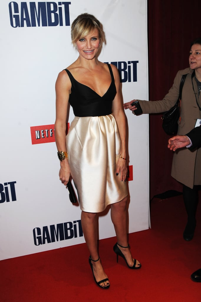 Cameron Diaz glowed in a black and gold Stella McCartney dress at the Gambit premiere in London.