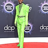 During the American Music Awards, he wore this lime green and zebra-printed suit by Christopher John Rogers.