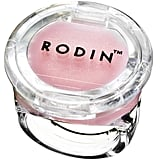"""""""I love this thing it's such a fun gift! I think anyone can appreciate this but especially a teenager. This is one of those throwback lip balm rings but done classy. Rodin's packaging is gorgeous and minimal and the products are all very simple. It's Jasmine and Neroli scent — two of my favorites.""""   Rodin Olio Lusso Lip Balm Ring  ($15)"""