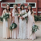These three bridesmaids coordinated perfectly in cream and pink dresses.