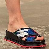 A crisscross peep-toe sandal with a sturdy leather sole.