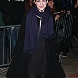 Anne Hathaway smiled for fans.