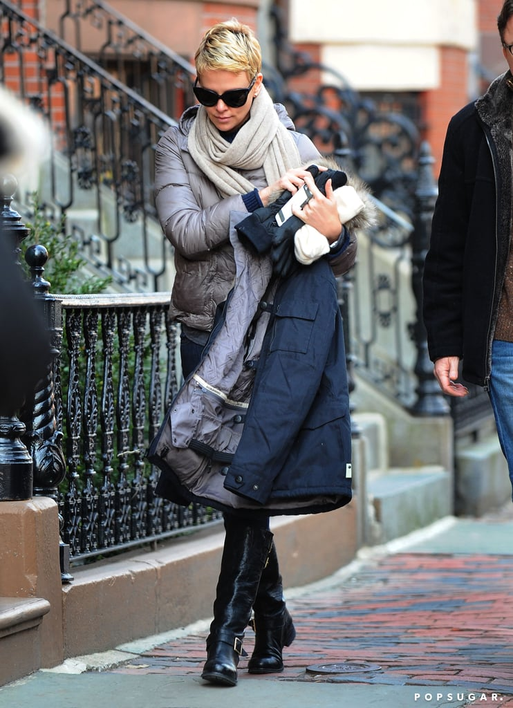Charlize Theron went to work on the set of Hatfields & McCoys in Boston yesterday. The East Coast weather didn't hinder her style as she arrived on site with a scarf, sunglasses, and a pair of black boots. The layered look was a far cry from her ensemble last week, when Charlize hiked Runyon Canyon in a tank top with her son, Jackson Theron. Charlize is stepping into the role of executive producer on NBC's new made-for-TV movie Hatfields & McCoys. The story of the infamous family feud was recently portrayed on the History Channel's Emmy-winning miniseries of the same name, with Kevin Costner and Bill Paxton. This version will feature an entirely new cast, including Sophia Bush, who was on the Hatfields & McCoys set yesterday as well.