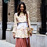 A Corset Over A Tunic Blouse And Skirt